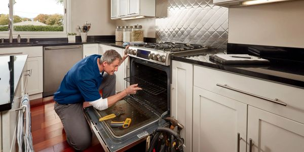 broken oven being fixed