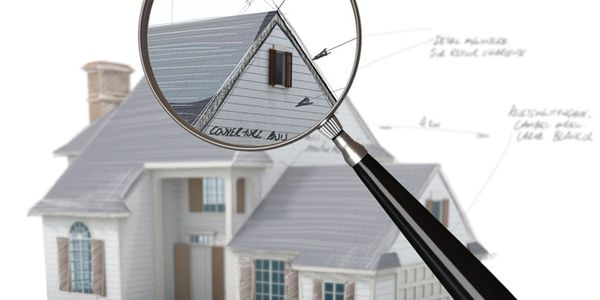 Looking at a house through a magnifying glass