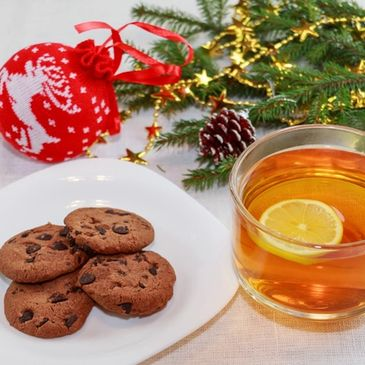 Christmas cookie and a cup of a hot drink on us