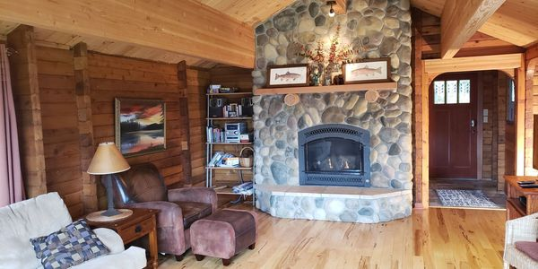 Cozy large living room with river rock fireplace.