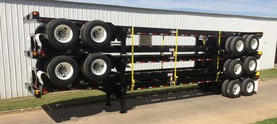 Standard 40ft chassis stacked 5 high, ready for road transport