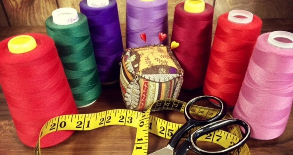 Thread, scissors, needle, measuring tape