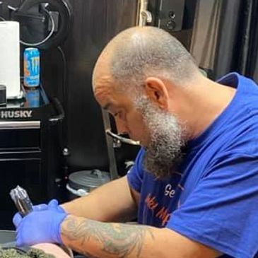 Tattoo and Piercing Artist