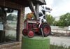 "XX - Winnipeg - Cow Driving a Tractor - Catton Ave & St. Mary Rd at Loch Gallery GPS: 49°52'21.8""N 97°06'54.2""W"