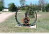"Nipawin - Tractor Wheel - north end of town on west side of Hwy 55 GPS: 53°22'48.6""N 104°00'03.2""W"