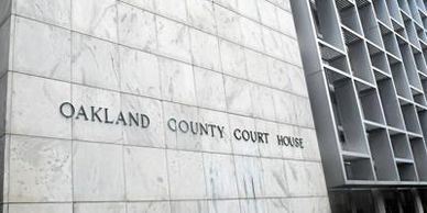oakland county circuit court criminal defense attorney lawyer affordable payment plan cheap assault