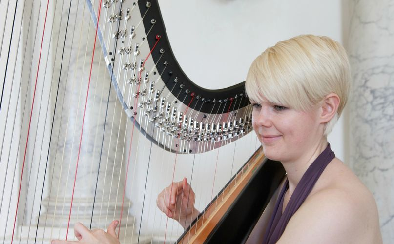 Harpist and singer Lizzie Peacock is available for weddings, concerts, and lessons, around Dorset.