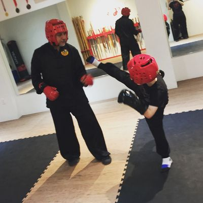 Sifu and student practicing sparring.