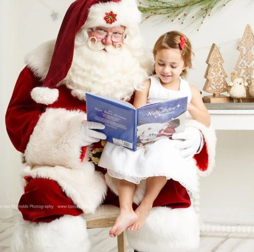 Santa Claus reading book to child
