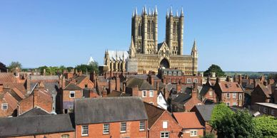 Lincoln Cathedral viewed across rooftops from the wall of Lincoln Castle