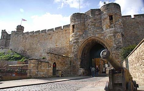 Front entrance to Lincoln Castle with a cannon in the foreground