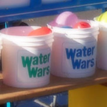 Water Wars West brings the fun to your event. Our staff fills water balloons. You simply take a bucket and enter your battle stations