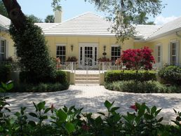 Fabulous 4 bedroom home in The Shores also provides two room guest suite with private entrance!