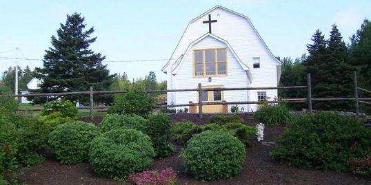 Freedom Bible Church with Faith's Garden in front.