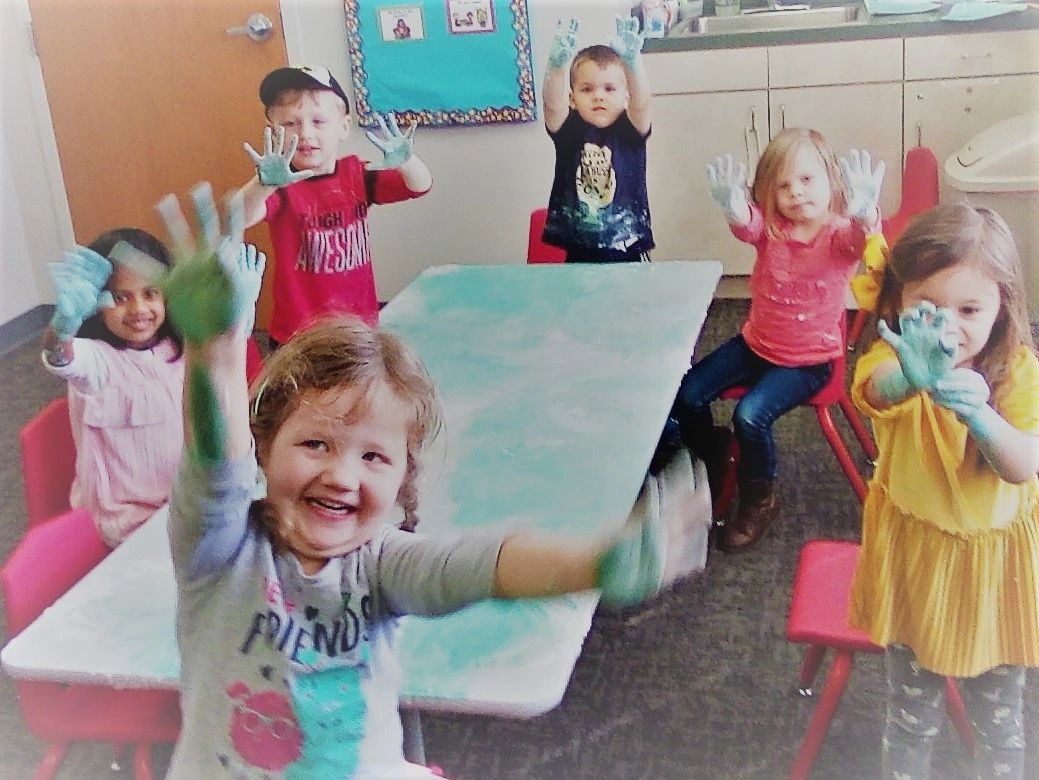 Preschool children enjoying hands on learning