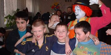 Russian orphans from Yekaterinburg, hamming it up with a clown