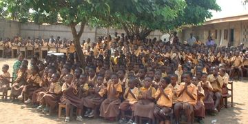 Ghanaian school children waiting at the Samaritan's Purse Operation Christmas Child distribution