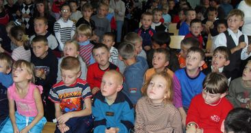Orphans from Voronezh Russia look on with joy at the team