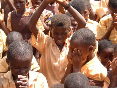 School children in Ghana pray after hearing the Good News during a Operation Christmas Child