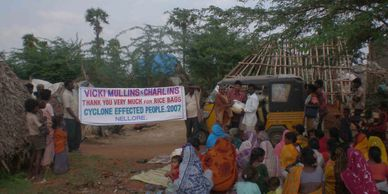 Delivery of humanitarian aid to cyclone affected villagers