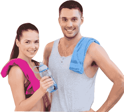 A woman and a man dressed in gym clothes smiling at the camera