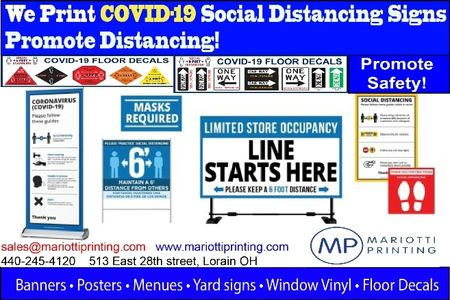 Covid-19 pandemic sign samples in full color after printing from a local print shop.