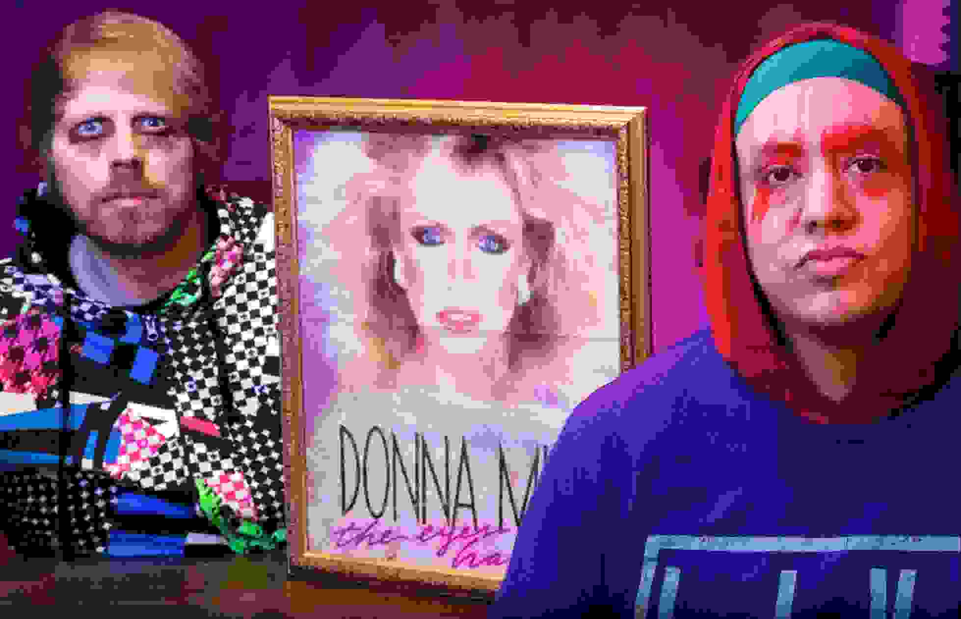 Robert Bacon and Nate Lopez showing off their most prized possession: a Donna Mills VHS promo poster