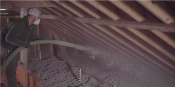 picture of man insulating an attic