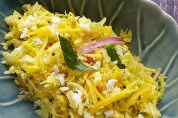 Cabbage grated raw mango & coconut  thoran / stir fry is an accompaniment infused tropical flavours.