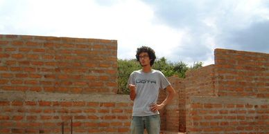 Daniel Budgell, founder of Posabilities, stands on the building site of Kanyama Village Dispensary
