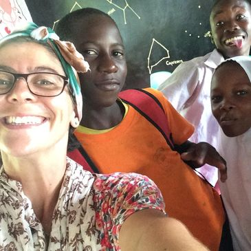 Director Sarah Phillips with school children at Ushongo Primary