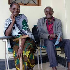 Village couple waits outside Kanyama Village Dispensary