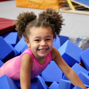 little girl gymnastics foam pit
