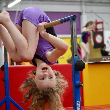Preschool gymnast on bars