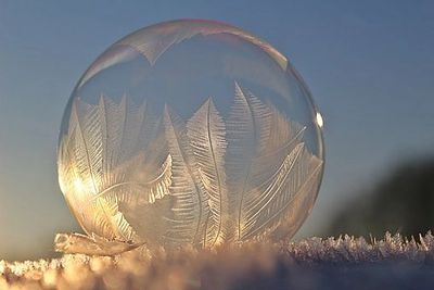 Frozen soap bubble with crystals.
