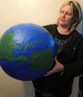 teacher with giant planet for science week 2020