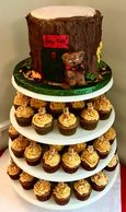 Tree stump mini shower cake with bear coordinates with the pumpkin spice cupcakes with a teddy gram.