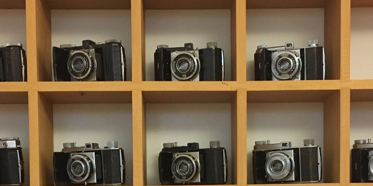A collection of 25 cameras.