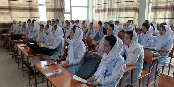 High school students attend an informational AGFAF session