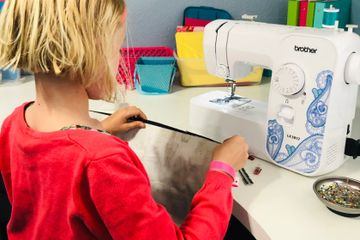 This is Izzy at summer camp.  She is sewing in the same model machine as we are giving away!