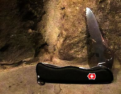 Swiss Army knife with locking blade and forward serrations.  The blade locks open.