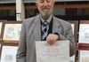 Malcolm Roberts receiving his Certificate from Ipswich Philatelic Society