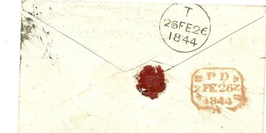 Back of envelope carrying the postmarks