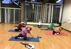 Mermaid in MAT class works obliques, arms and shoulders.