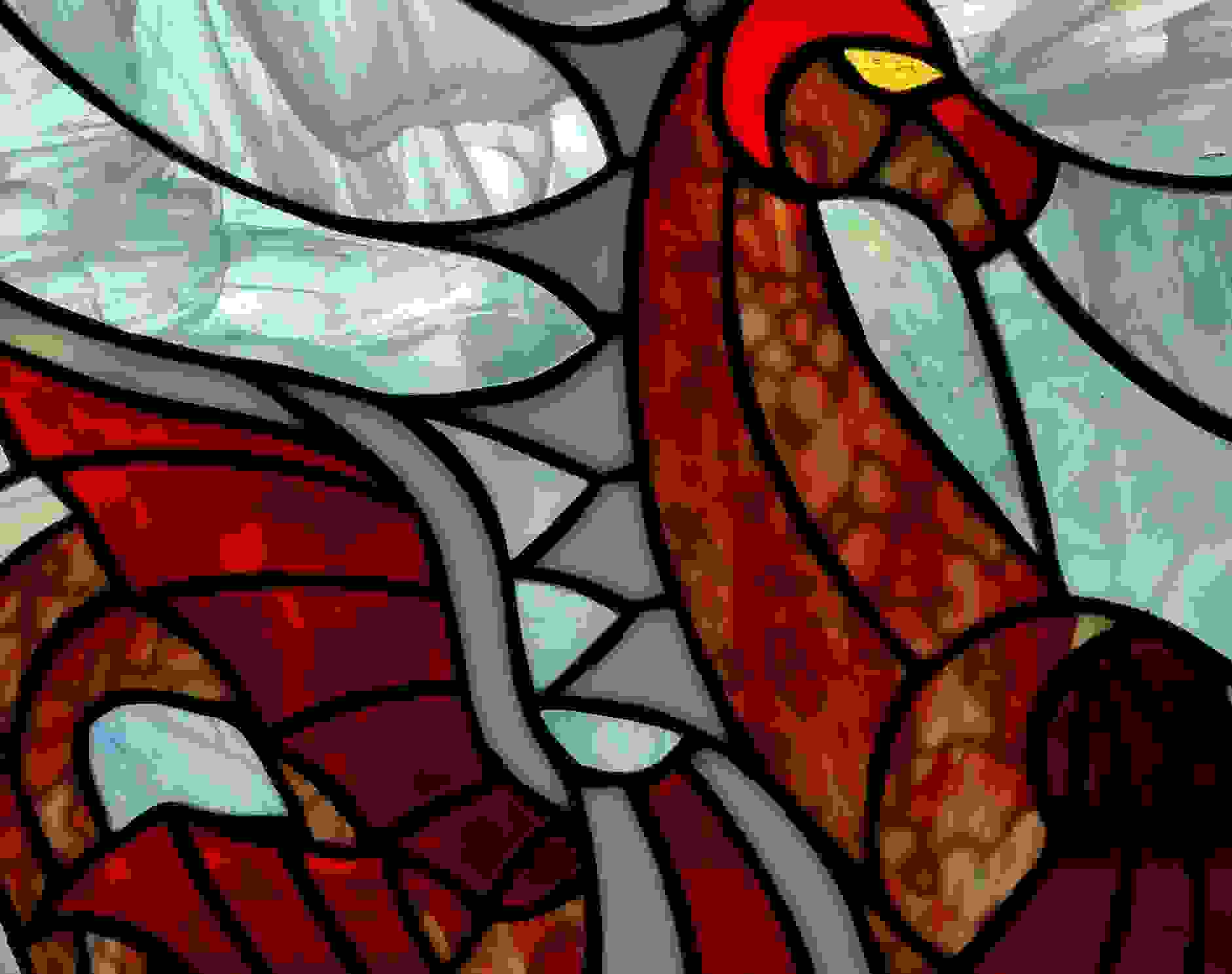 A stained glass piece of a red dragon