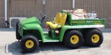 1999 John Deere 6-Wheeler with a 50 gallon water tank.