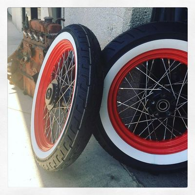 Powder coated red Harley Davidson Rims and white wall tires