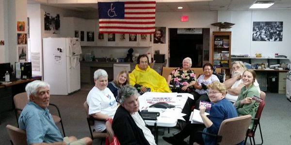 Photo of Austin Democrats with Disabilities at a meeting at ADAPT office, around a table