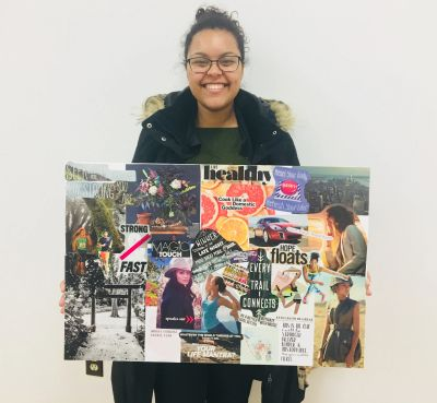 Woman holding a Vision Board