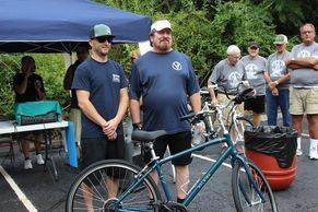 Left: Owner of the West Newton Bicycle Shop-Floyd Macheska.   Right: Winner Jim Smith.